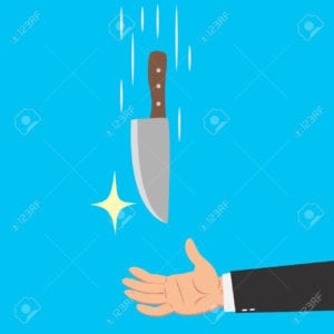 Hands of businessman catching a knife