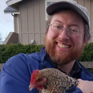 trader michael goode holding a rooster